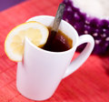 Cup with tea and sugar bowl Stock Images