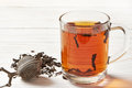 Cup of tea and tea strainer on wooden background Royalty Free Stock Photography
