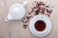 Cup of tea with teapot and spices on the table wood Royalty Free Stock Photo