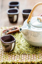 Cup of tea and teapot on wooden Stock Images