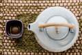 Cup of tea and teapot on wooden frame with asian Royalty Free Stock Photo