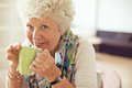 Cup of tea to brighten up my day closeup a happy senior woman drinking Royalty Free Stock Photography