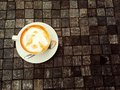 A cup of thai tea the orange on the brown block wood hot Royalty Free Stock Images