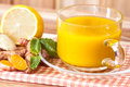 a cup of Turmeric Tea with lemon and ginger , Benefits for