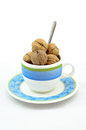 Cup of walnuts with a teaspoon Stock Photos