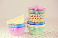 Cupcake baking cups still life of colorful pastel paper Royalty Free Stock Images