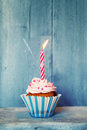 Cupcake birthday greeting card with and candle Royalty Free Stock Photo