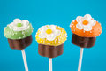 Cupcake cake pops mini cakes dipped in chocolate and decorated with sprinkles Stock Image