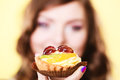 Cupcake cake in woman hand. Sweet food. Royalty Free Stock Photo