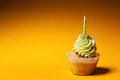 Cupcake with candle isolated on orange background Stock Photo