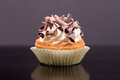Cupcake with chocolate chips american desserts butter cream and Royalty Free Stock Photography