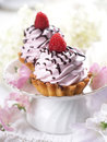 Cupcake with chocolate and raspberry selective focus Stock Photo