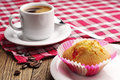 Cupcake and coffee cup of hot on wooden table Royalty Free Stock Images