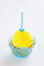 Cupcake with cream icing and birthday candle selective focus Royalty Free Stock Photography