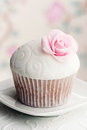 Cupcake decorated sugar rose Royalty Free Stock Photography