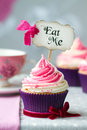 Cupcake with eat me pick Stock Image