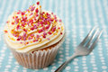 Cupcake with a Fork on a Spotty Napkin Royalty Free Stock Image