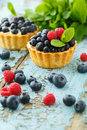 Cupcake with fresh blueberry and raspberry Royalty Free Stock Photo