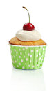 Cupcake with fresh cherry whipped cream and isolated on white background Royalty Free Stock Photo