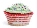 Cupcake with green icing and hundreds and thousands against white background Royalty Free Stock Image