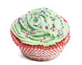 Cupcake with green icing and hundreds and thousands against white background Royalty Free Stock Photo