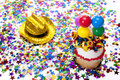 Cupcake, Hat, and Confetti at Party Stock Photo