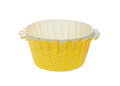 Cupcake liner yellow with white dots Stock Photos