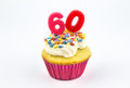 Cupcake with number sixty - 60 - pink candles with white vanilla Royalty Free Stock Photo