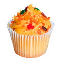 Cupcake with orange frosting and colored sprinkles isolated on white. Sweet food for Halloween Royalty Free Stock Photo