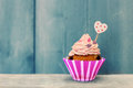 Cupcake photo of cute on wooden background Stock Photo
