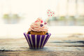 Cupcake photo of cute on wooden background Royalty Free Stock Photography