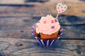 Cupcake photo of cute on wooden background Royalty Free Stock Photos