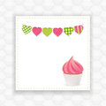 Cupcake with pink icing on a panel background with bunting Royalty Free Stock Images