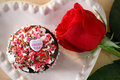 Cupcake and a rose Royalty Free Stock Photography