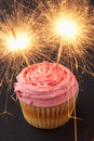 A cupcake with sparklers Royalty Free Stock Photo