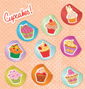Cupcake stickers on a polka dot grunge paper Stock Photography
