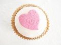 Cupcake a with sugar paste pink heart Stock Photos