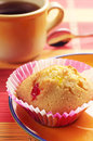 Cupcake and tea cup of on colorful bamboo napkin Royalty Free Stock Image