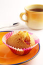 Cupcake and tea in yellow plate cup of on white background Stock Photos