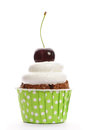 Cupcake with whipped cream and cherry Royalty Free Stock Image