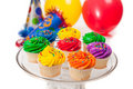 Cupcakes, balloons and party hats Royalty Free Stock Image