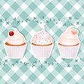 Cupcakes on blue gingham Royalty Free Stock Image