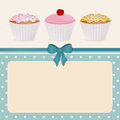 Cupcakes on blue polka dot background Royalty Free Stock Photography