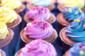 Cupcakes colorful in window display in store Royalty Free Stock Image