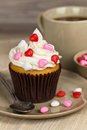 Cupcakes with frosting and hearts valentine selective focus Royalty Free Stock Photo