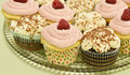 Cupcakes glass tray of decorated Royalty Free Stock Images