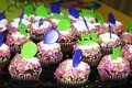 Cupcakes happy birthday purple green balloons Stock Images