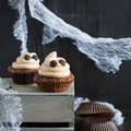 Cupcakes like a ghost. Halloween dessert. Royalty Free Stock Photo