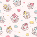 Cupcakes and macaroons seamless pattern Stock Photos