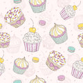 Cupcakes and macaroons seamless pattern Stock Photography